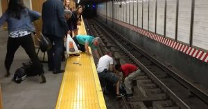 strangers_rescue_man_from_subway_tracks_featured