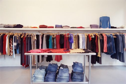 Clothes on rack and table in store