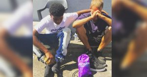 teen_gives_homeless_man_shoes_off_his_feet_featured
