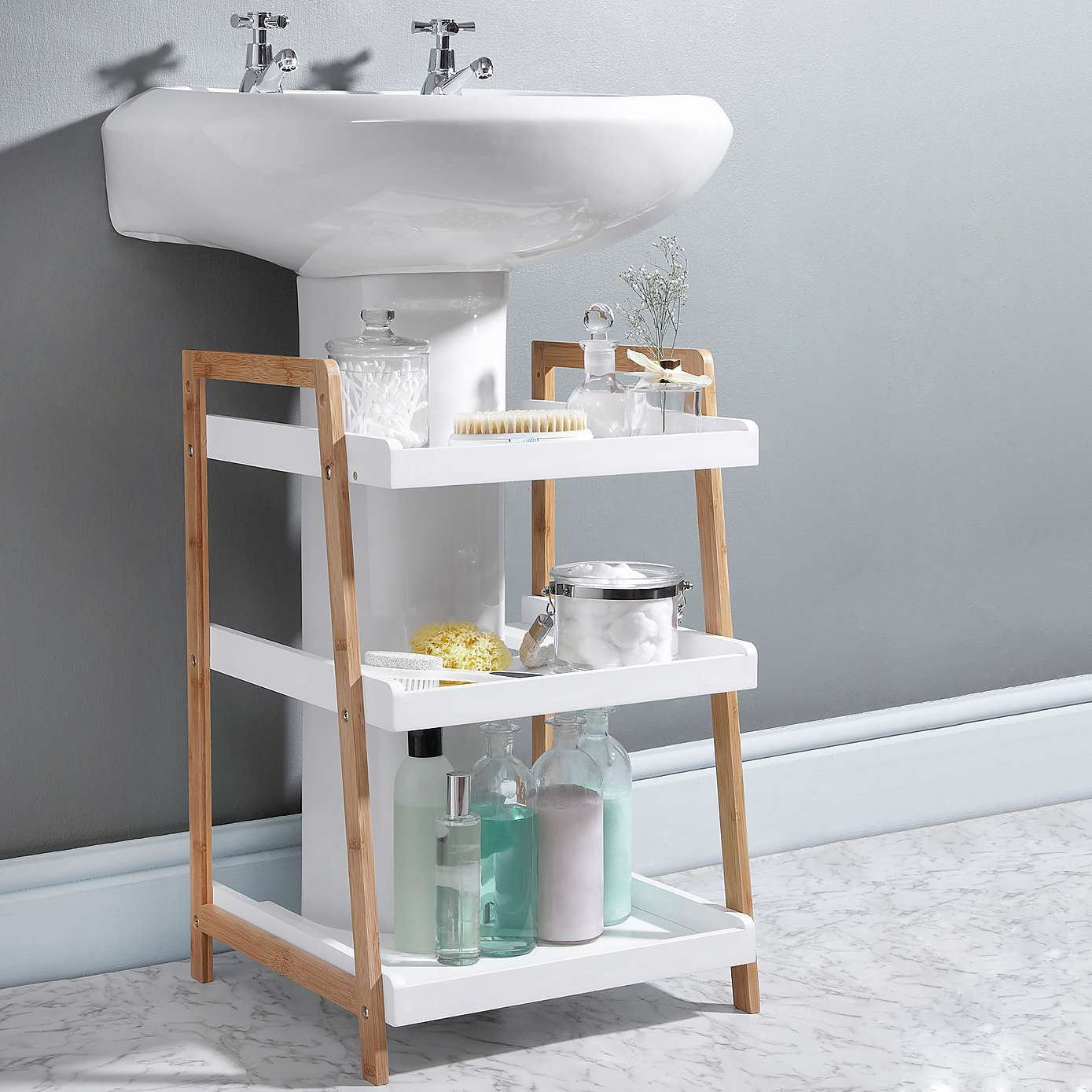 Mom likes to keep her bathroom neat and tidy see her 9 for Bathroom under sink organizer